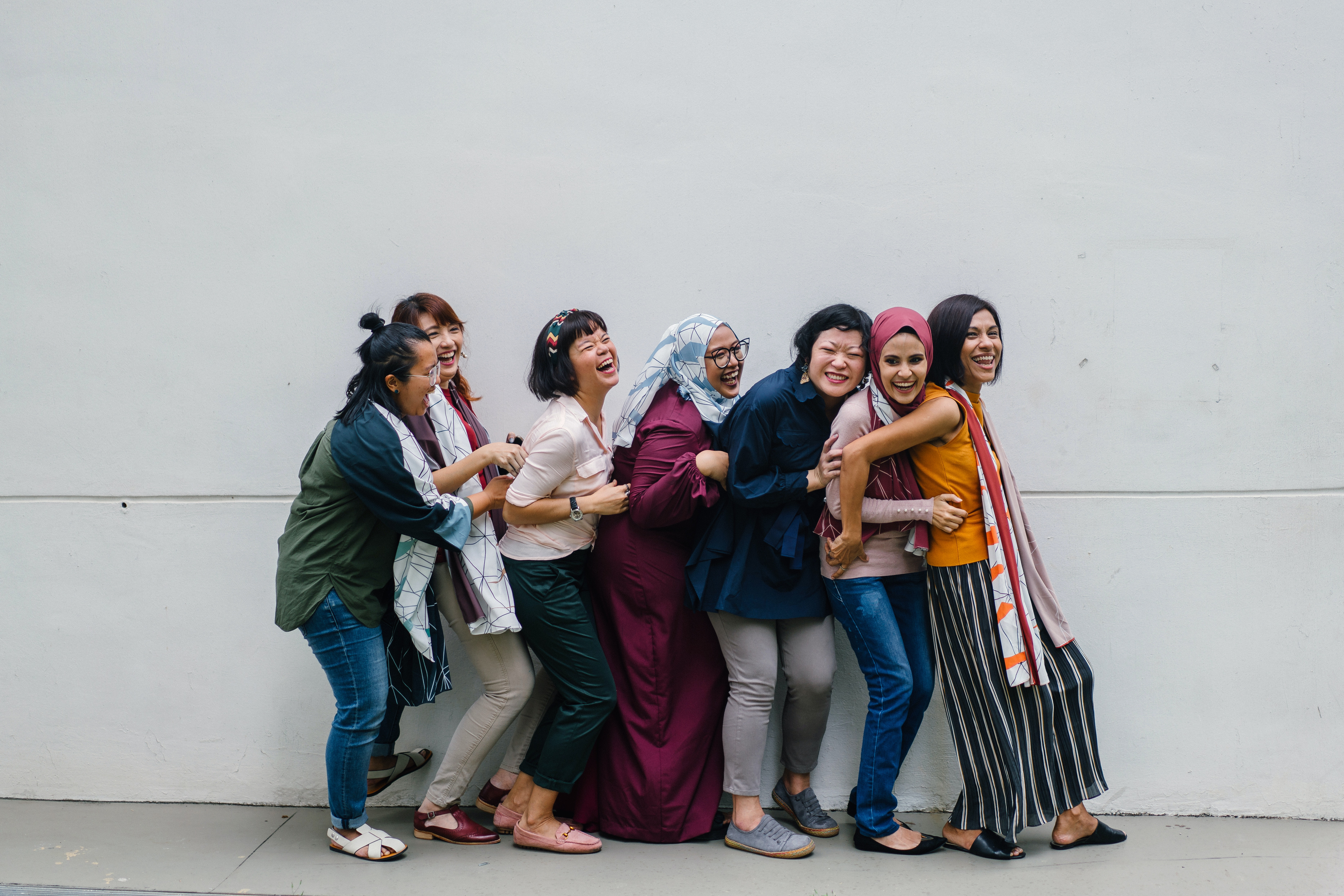 group-of-smiling-women-form-different-cultures